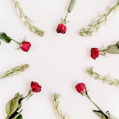 Red roses and white flowers
