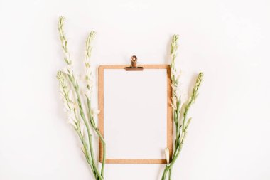 Clipboard and white flowers