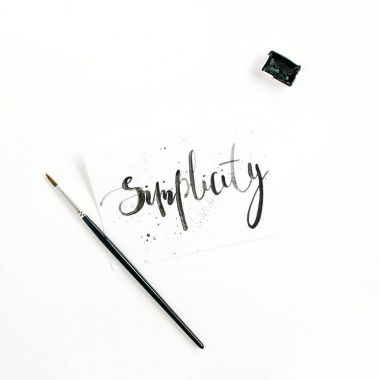 Minimalistic stylish composition with word Simplicity