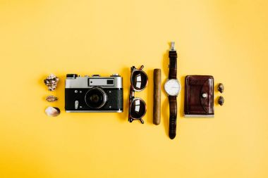 traveler accessories on yellow background