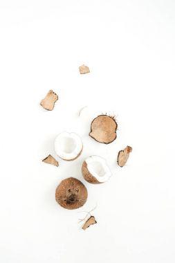 Cracked coconut on white background