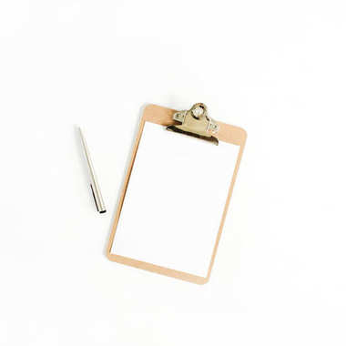 Clipboard and pen on white background