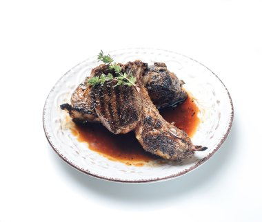 Grilled lamb steaks on plate