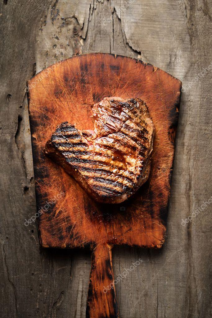 grilled juicy steak on cutting board