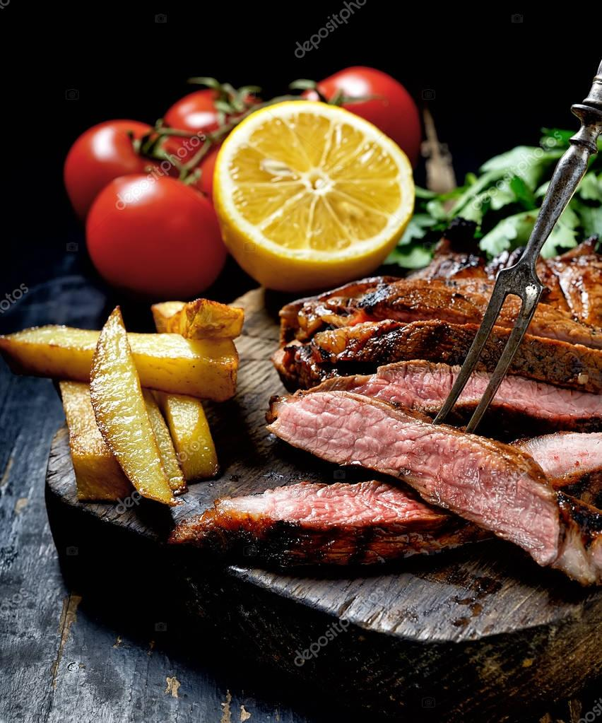 Steak with herbs with french fries