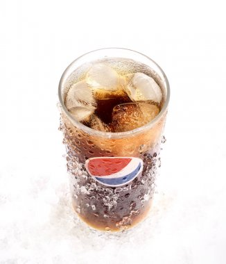 POLTAVA, UKRAINE - MARCH 22, 2018: Cold glass of Pepsi-Cola with ice on white background. Pepsi is a carbonated soft drink sold in stores, restaurants, and vending machines throughout the world.