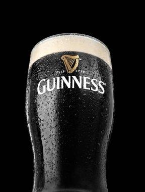 Glass of Guinness original beer on black background