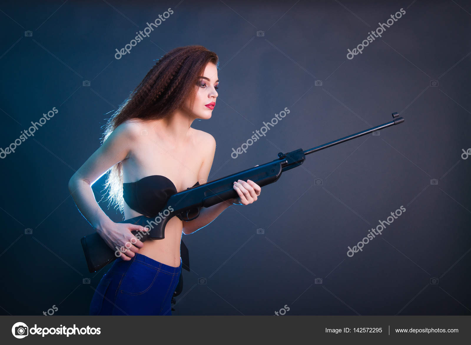 Dark haire girls with pistols matchless