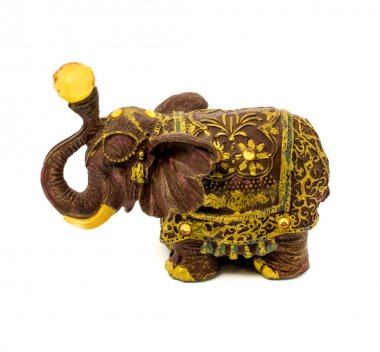 Statuette of brown elephant with yellow sapphire isolated on a white background
