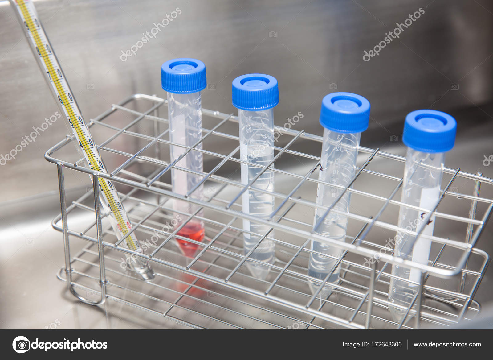 Falcon tubes and rack in a hot water bath — Stock Photo © anamejia18 ...