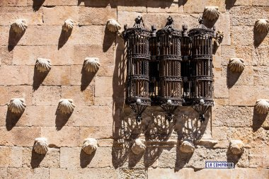 Detail of the windows of the historical House of the Shells built in 1517 in Salamanca, Spain