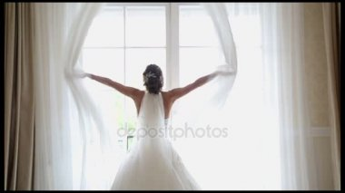 Bride opens curtains
