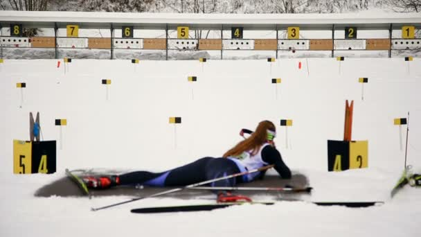 Ukraine. Yavoriv. 04 January 2020. Skier who takes part in the biathlon race, shoots a rifle at a target lying down