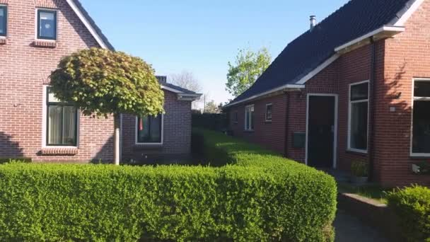 Village of Holland. Small red-brick houses. Beautiful streets in a small Dutch village., Netherlands