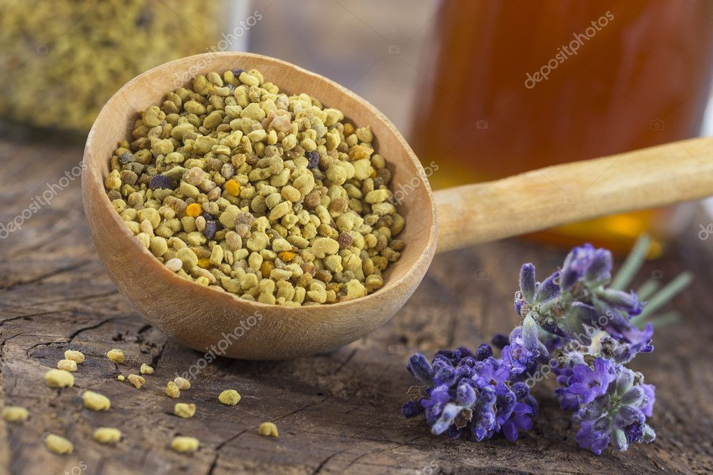 bee pollen in the spoon on  wooden background