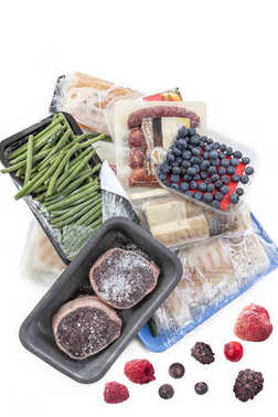concept of freezing, bunch of frozen food meat, Vegetables, fish, fruits, on a white background