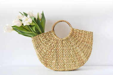 Wicker Handbag with Flowers Tulips, Spring Time, Summer Concept, White Background, Copy Space