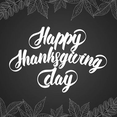 Hand lettering text of Happy Thanksgiving Day. Handmade calligraphy. Floral leaves design on blackboard background.