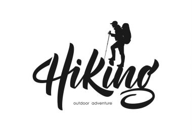 Vector illustration: Modern brush lettering of Hiking with silhouette of climber
