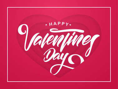 Romantic greeting card with hand drawn lettering of Happy Valentines Day in red paper hearts background