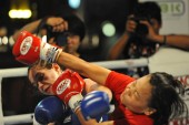 BANGKOK, THAILAND - January 23, 2013: Unidentified fighters competiting in amateur Thai Kickboxing, or Muay Thai.