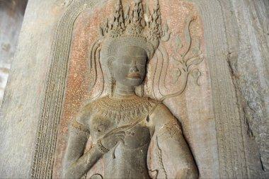 Closeup of Goddess sculpture on stone wall