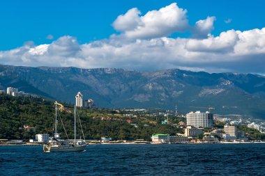 The yacht sails along the southern coast of Crimea