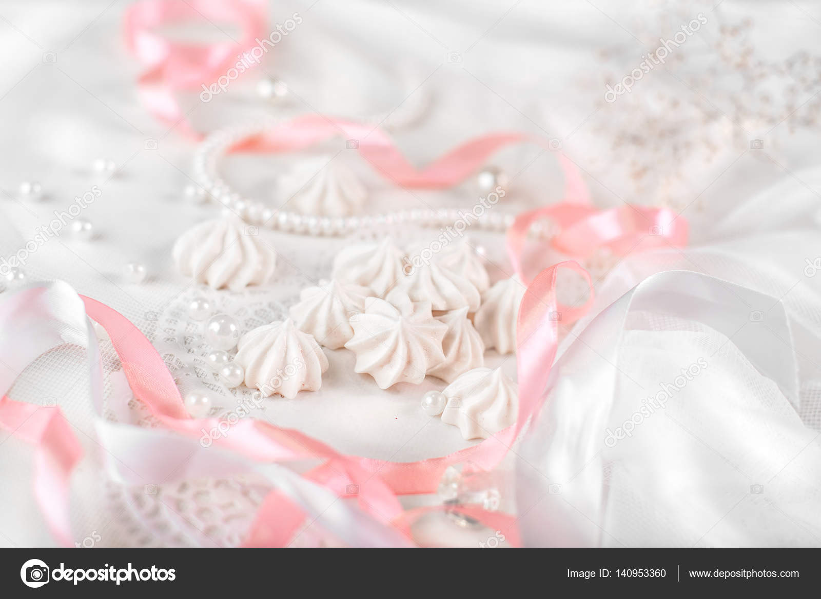 French meringue cookies for wedding background with pearls, pink and ...