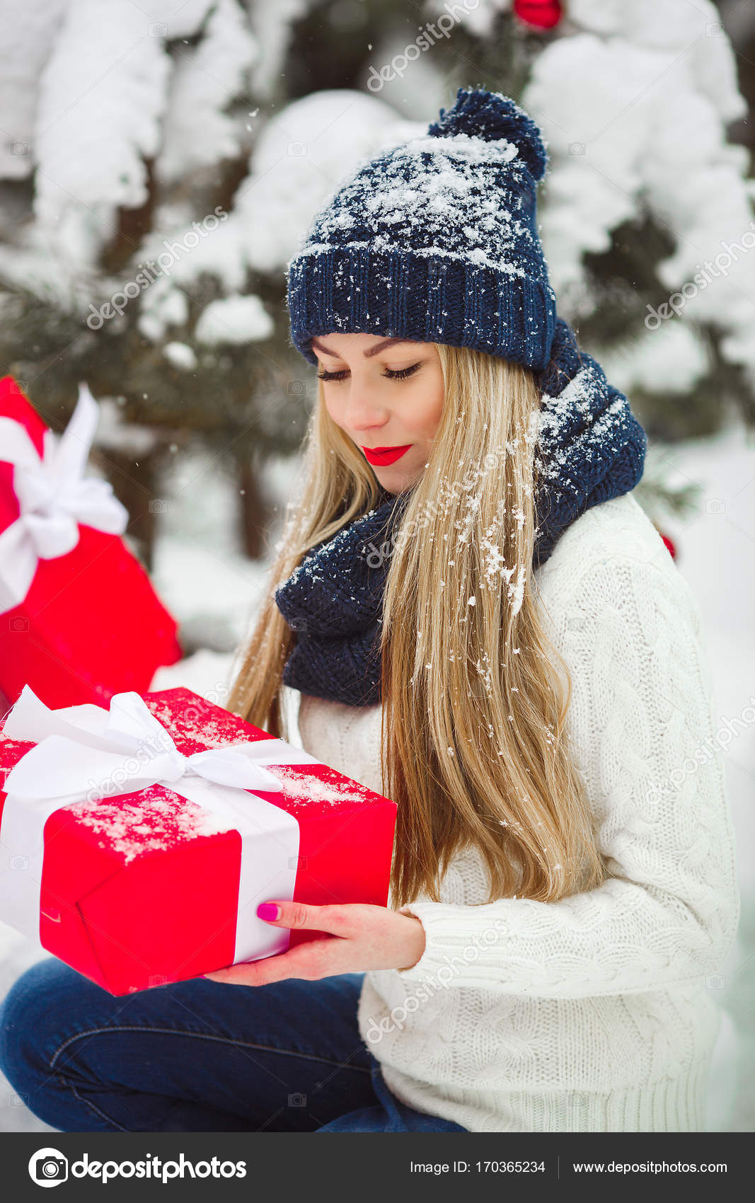 Beautiful woman with christmas gifts outdoors — Stock Photo ...