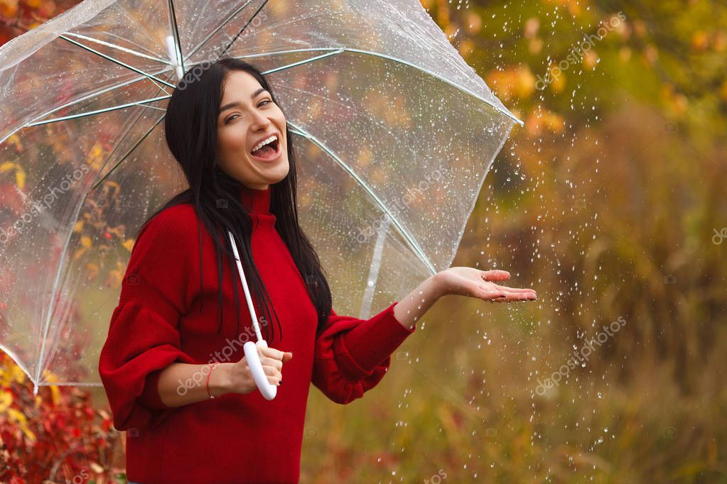 Beautiful woman holding umbrella