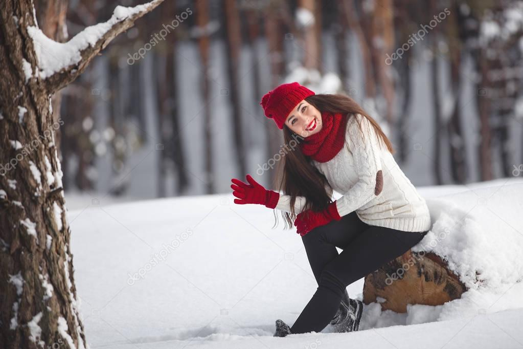 Portrait of a beautiful woman on a winter background.