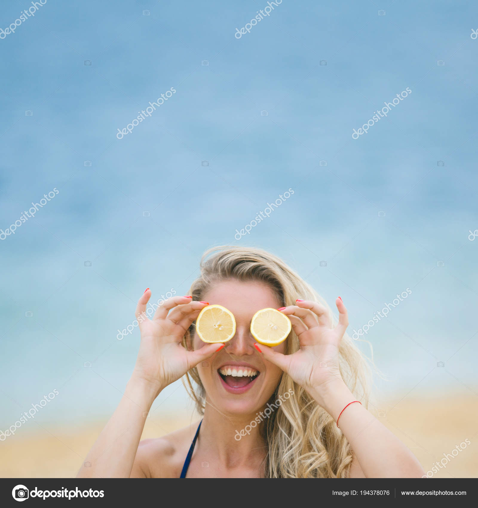 Young Attractive Woman Covering Her Eyes Lemon Slices