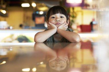 Thoughtful portrait of little girl