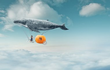 whale with pumpkin and two girls over clouds