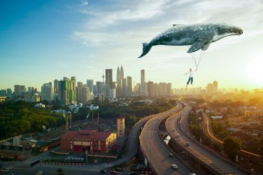 man and big whale flying over cityscape