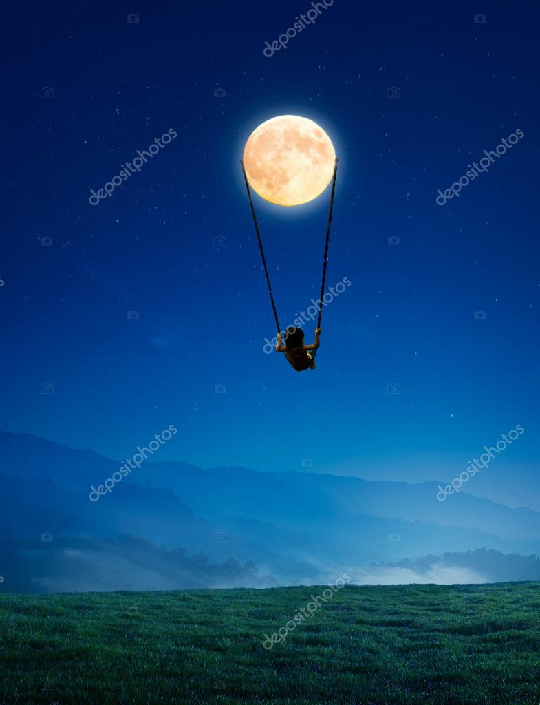 Little girl on moon swing
