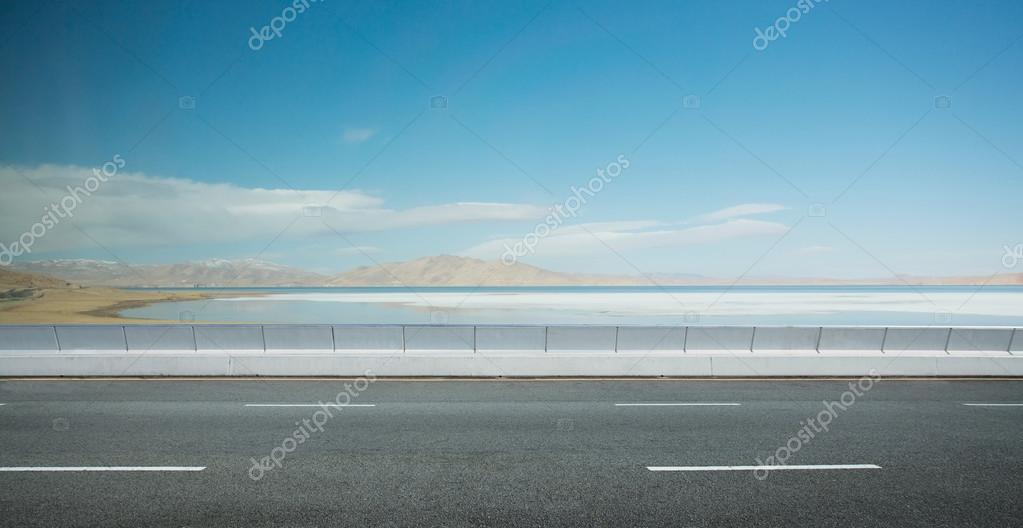 Empty asphalt road against nature landscape