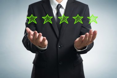 Businessman with five star rating
