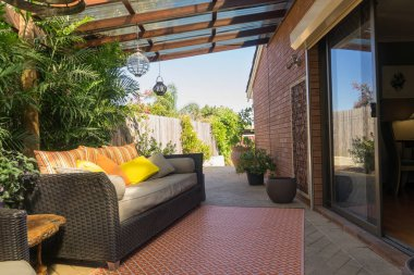 Sofa with pillows in patio
