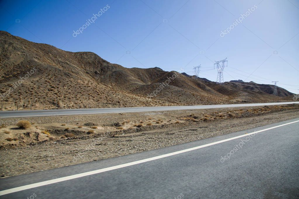 Asphalt road in desert