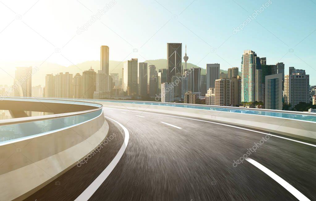 Highway overpass with modern city skyline