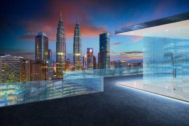Empty glass balcony with kuala lumpur city skyline , night scene .