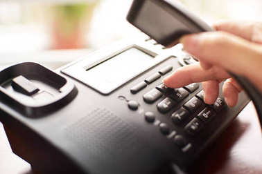 Telephone dialing ,contact and customer service concept . Selected focus