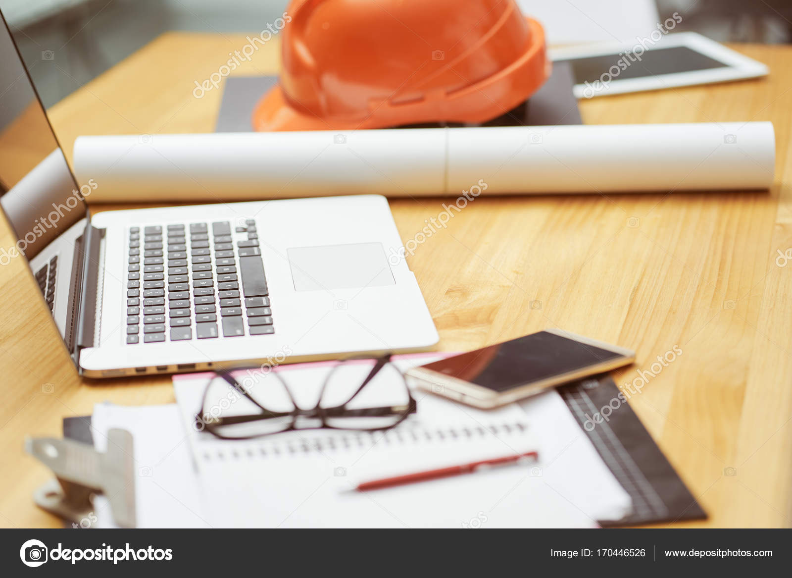 Laptop glasses note book phone blueprint orange safety helmet laptop glasses note book phone blueprint and orange safety helmet stacking on table at construction site for engineer foreman and worker selective malvernweather Images
