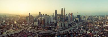 Panorama aerial view in the middle of Kuala Lumpur cityscape skyline , early morning sunrise scene, Malaysia .