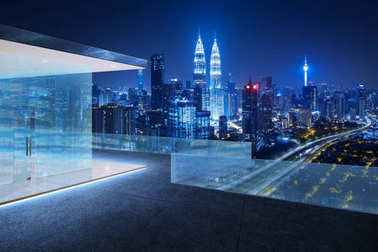 Glass railings and tile floor rooftops with night city skyline background