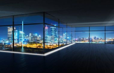 Perspective view of empty wood floor and cement ceiling interior with city skyline view . Mixed media .