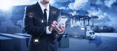Businessman touching smartphone for analyze stock at logistics p