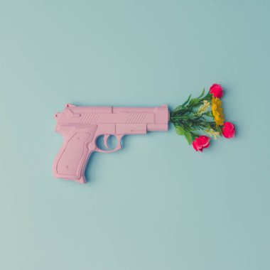 Pink handgun with flowers