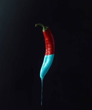Red pepper with dripping blue paint